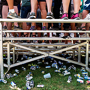 Trash and beer cans lay under the bleachers during the 28th annual Hog Wrestling Competition at Caldron Falls Bar in Twin Bridge, Wis., on July 20, 2013. Lukas Keapproth/Press Gazette Media