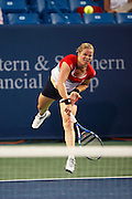 CINCINNATI, OH - AUGUST 10: Former top-ranked women's tennis player Kim Clijsters of Belgium in action during Day 1 of the Western & Southern Financial Group Women's Open on August 10, 2009 at the Lindner Family Tennis Center in Cincinnati, Ohio. Clijsters defeated 12th seeded Marion Bartoli 6-4, 6-3 in her first match in 28 months after coming out of retirement. (Photo by Joe Robbins)