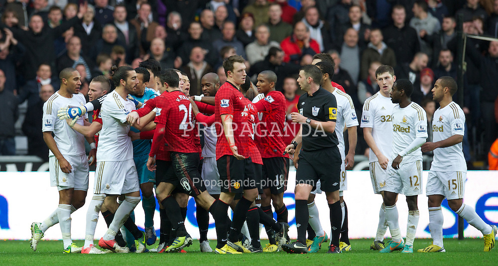 SWANSEA, WALES - Sunday, December 23, 2012: Manchester United's Robin van Persie clashes with Swansea City's captain Ashley Williams during the Premiership match at the Liberty Stadium. (Pic by David Rawcliffe/Propaganda)