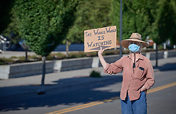 A man holds a sign during a June 3, 2020, Black Lives Matter protest in Eugene, Oregon. Participants were protesting the murder of George Floyd and other African-Americans by police.