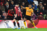 Adama Traore (37) of Wolverhampton Wanderers looks for a way past Diego Rico (21) of AFC Bournemouth during the Premier League match between Bournemouth and Wolverhampton Wanderers at the Vitality Stadium, Bournemouth, England on 23 November 2019.