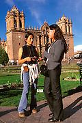 PERU, HIGHLANDS, CUZCO Plaza de Armas; Peruvian students