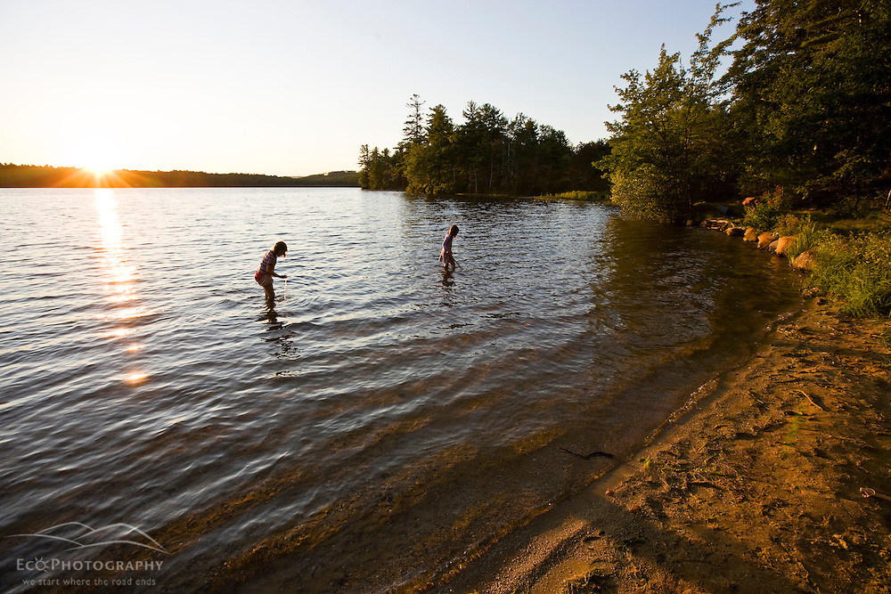 Girls play in Otter Lake in Greenfield State Park in Greenfield, New Hampshire.