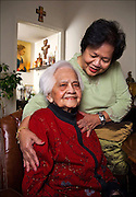 Client: San Mateo Medical Center's annual report - Belen Esperitu with her 105 year old mother Josefina. They are very happy with the care Josefina has received at the hospital's Ron Robinson Senior Care Center.