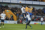 Jake Lawlor of Guiseley AFC (6) with Jimmy Spencer of Mansfield Town (15) and Danny Rose of Mansfield Town (32) during the The FA Cup match between Mansfield Town and Guiseley  at the One Call Stadium, Mansfield, England on 3 December 2017. Photo by Mick Haynes.