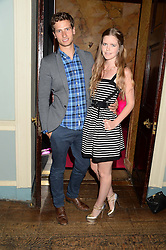 KATIE READMAN and TOM WARREN at the Juicy Couture - Viva La Juicy perfume Party held at Home House, Portman Square, London on 30th May 2013.