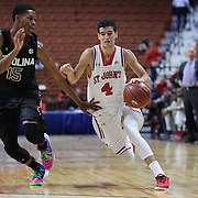 Federico Mussini, (right), St. John's, drives past PJ Dozier, South Carolina, during the St. John's vs South Carolina Men's College Basketball game in the Hall of Fame Shootout Tournament at Mohegan Sun Arena, Uncasville, Connecticut, USA. 22nd December 2015. Photo Tim Clayton