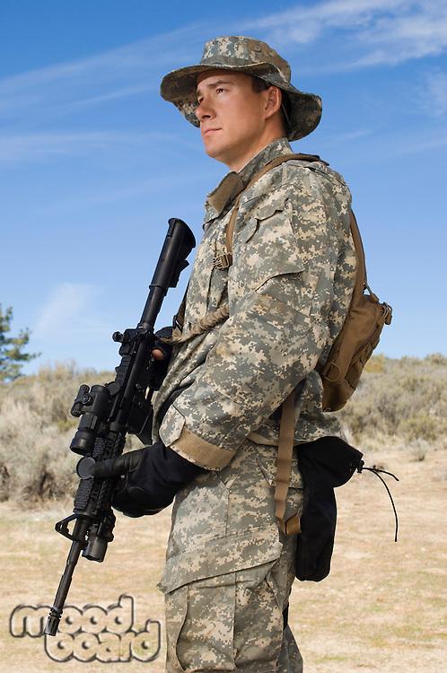 Portrait of soldier with machine gun