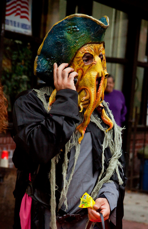 What happens to you from using a cell phone. Taken at the Halloween Day Parade in Park Slope, Brooklyn.