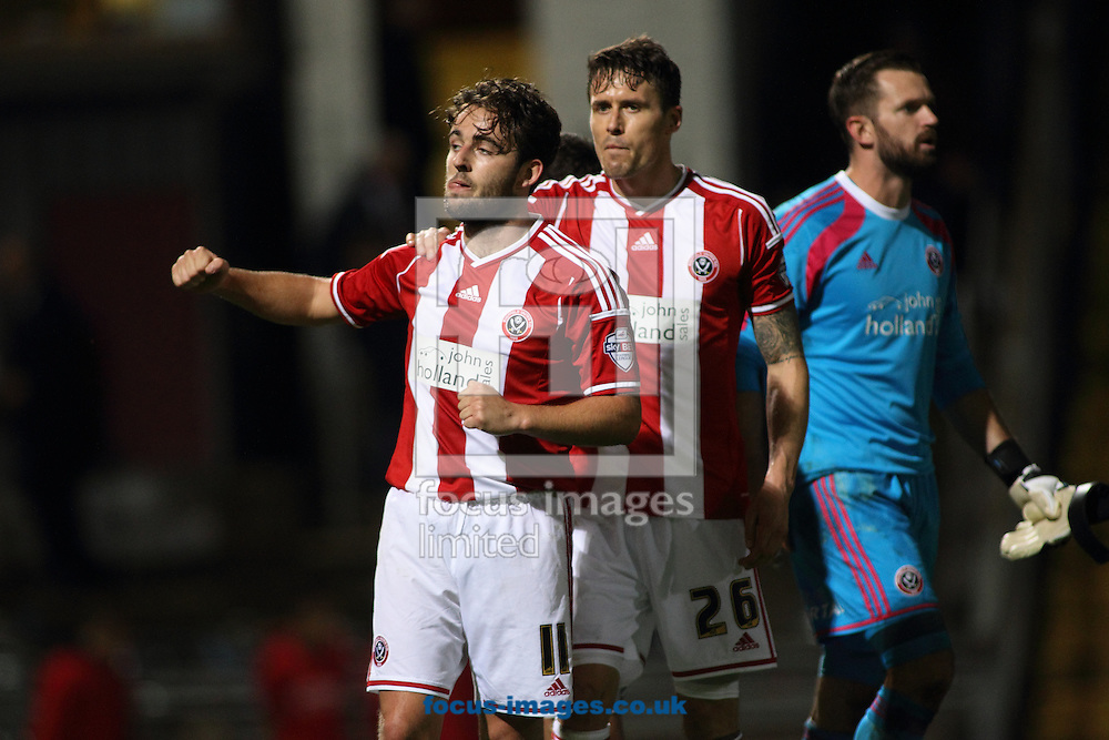 Jose Baxter (L)  of Sheffield United celebrates the 2-0 win over Bradford City during the Sky Bet League 1 match at the Coral Windows Stadium, Bradford<br /> Picture by Stephen Gaunt/Focus Images Ltd +447904 833202<br /> 18/10/2014