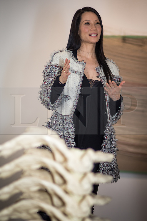 """© Licensed to London News Pictures . FILE PICTURE DATED 17/05/2013 . The Popular Institute , Manchester , UK . American actress and model LUCY LIU at a preview of her art exhibition , """" Totem """" which is open to the public from this Tuesday (21st May) until June 22nd . Her work features a series of hand stitched linen canvases and sculptures which , she says , explores the fragility of the human form through a recurring theme of the human spine . Liu said she chose Manchester as she likes its """" underground """" cultural scene and that """" people can get a bit jaded with the whole London scene """" . The exhibited works are for sale for between £8,000 and £16,000 with all profits going to UNICEF . Photo credit : Joel Goodman/LNP"""
