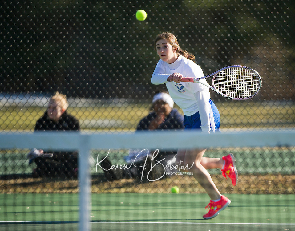 Emily Hanf of Gilford makes a forehand return during her singles match with Mary Sapack of Interlakes during Wednesday afternoon's season opener.  (Karen Bobotas/for the Laconia Daily Sun)