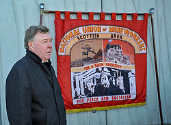 Pictured: Mick McGahey's son Michael McGahey speaking at the wreath laying.<br /> <br /> Labour MSP's and National Union of Mineworkers (NUM) campaigners laid wreaths and held a short vigil outside the Scottish Parliament. Speakers included Scottish Labour leader Richard Leonard, NUM president Nicky Wilson and Mick's son, Michael MxGahey.<br /> <br /> &copy; Dave Johnston / EEm