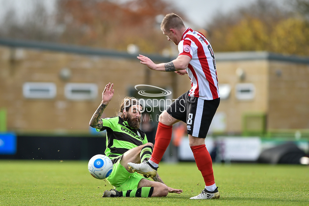 Forest Green Rovers Midfielder, Rob Sinclair (19) tackles Lincoln City Midfielder, Alan Power (8) during the Vanarama National League match between Forest Green Rovers and Lincoln City at the New Lawn, Forest Green, United Kingdom on 19 November 2016. Photo by Adam Rivers.