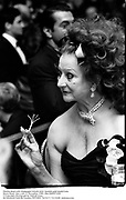 Martha Reed with champagne twizzle stick. Spanish gold medal Gala. Pierre Hotel. New york 17 November 1989. film DJ89571f20<br />