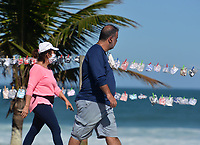 Rio de Janeiro-Brazil May 9, 2020, population movement on the edge of Barra da Tijuca beach, even with the quarantine. Masks are being sold on the beach sidewalk