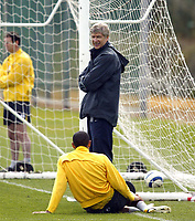 Photo: Chris Ratcliffe.<br /> Arsenal Training Session. UEFA Champions League. 18/04/2006.<br /> Arsene Wenger smiles at Thierry Henry during training