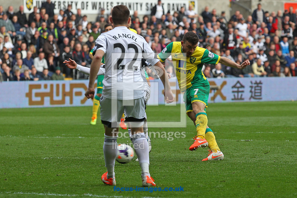 Robert Snodgrass of Norwich has a shot on goal during the Barclays Premier League match at the Liberty Stadium, Swansea<br /> Picture by Paul Chesterton/Focus Images Ltd +44 7904 640267<br /> 29/03/2014