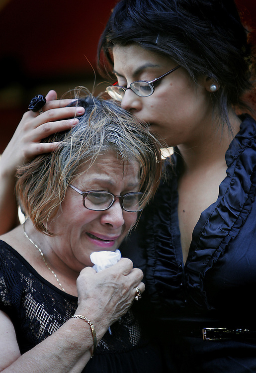 Reina Rivera, mother of Jacqueline Leavey, is comforted by her granddaughter Sylvana Lopez during a funeral service for Leavy and her children, Victor and Abbey Alanis, at the Logan City Cemetery in Logan, Utah. Leavey and her children were killed when a landslide demolished their home.