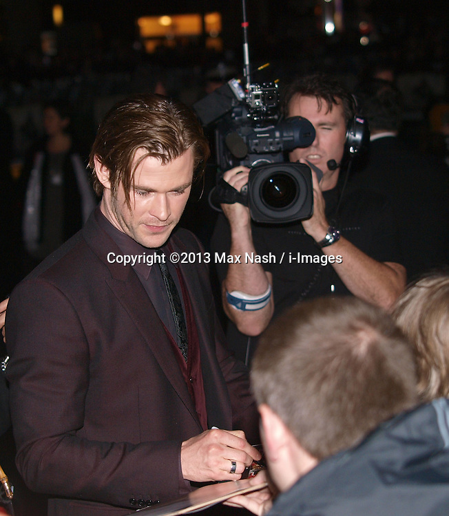Actor Chris Hemsworth, centre, with his fans as he arrives for the World Premiere of his latest film Thor The Dark World.  in London's Leicester Square, England, United Kingdom. Tuesday, 22nd October 2013. Picture by Max Nash / i-Images