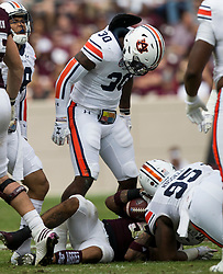 Auburn linebacker Tre' Williams (30) reacts after stopping Texas A&M running back Trayveon Williams (5) on a run during the first quarter of an NCAA college football game on Saturday, Nov. 4, 2017, in College Station, Texas. (AP Photo/Sam Craft)