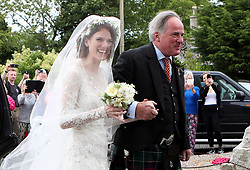 Rose Leslie with her father Sebastian Leslie arrive at Rayne Church, Kirkton of Rayne in Aberdeenshire, for her wedding ceremony with Game Of Thrones co-star Kit Harington.