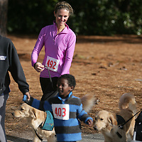 Meredith McCumbee watches Aaron McCumbee,4, run as she walks their dog Hattie in the Paws for People 5K. (Jason A. Frizzelle)