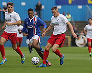 Liam Hughes battles during the Pre-Season Friendly match between Barrow and Carlisle United at Holker Street, Barrow, United Kingdom on 23 July 2016. Photo by Pete Burns.