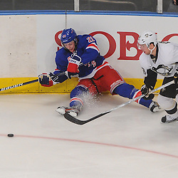 New York Rangers center Derek Stepan (21) tries to make a pass from  the ice after being wiped out by Pittsburgh Penguins center Tyler Kennedy (48) during second period NHL action between the Pittsburgh Penguins and the New York Rangers at Madison Square Garden in New York, N.Y.