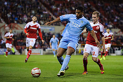 Plymouth Forward Reuben Reid (ENG) is challenged by Swindon Defender Jack Barthram (ENG) during the second half of the match - Photo mandatory by-line: Rogan Thomson/JMP - Tel: Mobile: 07966 386802 08/10/2013 - SPORT - FOOTBALL - County Ground, Swindon - Swindon Town v Plymouth Argyle - Johnstone Paint Trophy Round 2.