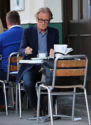 (EXCLUSIVE PICTURES) Actor Bill Nighy spotted reading Keeping An Eye Open by Julian Barnes and enjoying a coffee at a restaurant in north London, UK. 09/09/2015<br />