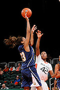 December 18, 2010: Jazzmin Lewis of the California Riverside Highlanders shoots over Shenise Johnson of the Miami Hurricanes during the NCAA basketball game between the Hurricanes and the Highlanders. The 'Canes defeated the Highlanders 81-59.