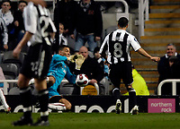 Photo: Jed Wee/Sportsbeat Images.<br /> Newcastle United v AZ Alkmaar. UEFA Cup. 08/03/2007.<br /> <br /> Newcastle's Kieron Dyer (R) lifts the ball over Alkmaar goalkeeper Boy Waterman for the second goal of the game.