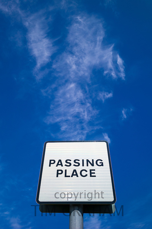 Passing Place sign on narrow single track road in the Scottish Highlands
