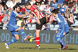 08.01.2012, Stadion Coliseum Alfonso Perez, Getafe, ESP, Primera Division, FC Getafe vs Athletic Bilbao, 18. Spieltag, im Bild Getafe's Daniel Guiza against Athletic de Bilbao's Oscar de Marcos // during the football match of spanish 'primera divison' league, 18th round, between FC Getafe and Athletic Bilbao at Coliseum Alfonso Perez stadium, Getafe, Spain on 2012/01/08. EXPA Pictures © 2012, PhotoCredit: EXPA/ Alterphotos/ Alvaro Hernandez..***** ATTENTION - OUT OF ESP and SUI *****