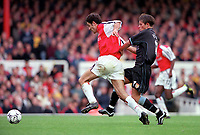 Robert Pires (Arsenal) is held back by Aston Villa's Lee Hendrie (who is eventually booked and sent off for a 2nd bookable offence by referee Rob Harris). Arsenal 1:0 Aston Villa, F.A.Carling Premiership, 13/10/2000. Credit Colorsport / Stuart MacFarlane.