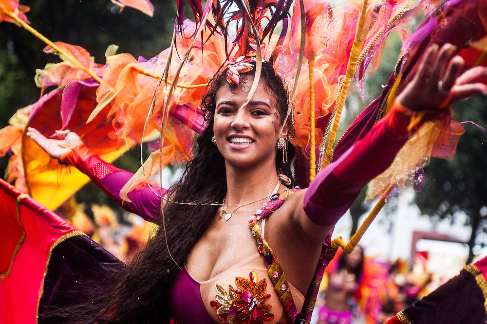 London, UK - 25 August 2014: a reveller takes part in the parade during the Notting Hill Carnival in London.