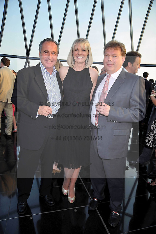 Left to right, BILL BROADBENT, NIKKI PAGE mbassador at Large for the Variety Club's Children's Charitya and GARY DAVIS at the Variety Club gala evening held at The Gherkin, St.Mary Axe, City of London on 2nd July 2009.