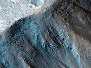 This observation from NASA's Mars Reconnaissance Orbiter (MRO) shows the very steep side of a plateau, part of the northern limit of the Kasei Valles system, which is one of the largest outflow channel systems on Mars.