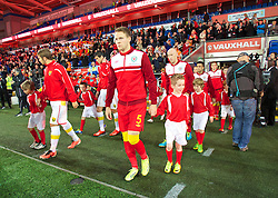 CARDIFF, WALES - Friday, October 11, 2013: Wales' Chris Gunter walks out to face Macedonia during the 2014 FIFA World Cup Brazil Qualifying Group A match at the Cardiff City Stadium. (Pic by David Rawcliffe/Propaganda)