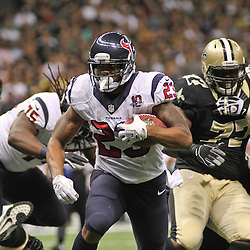 August 25, 2012; New Orleans, LA, USA; Houston Texans running back Arian Foster (23) runs for a touchdown against the New Orleans Saints during the first half of a preseason game at the Mercedes-Benz Superdome. Mandatory Credit: Derick E. Hingle-US PRESSWIRE