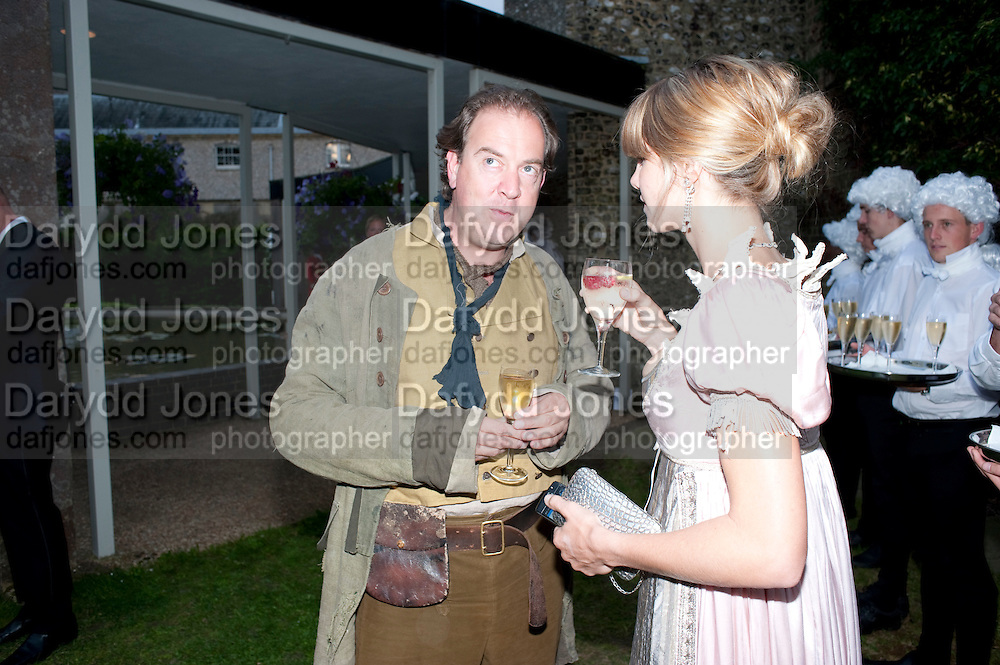 MARK CORNELL; DELFINA BLAQUIER, The Goodwood Ball. In aid of Gt. Ormond St. hospital. Goodwood House. 27 July 2011. <br /> <br />  , -DO NOT ARCHIVE-© Copyright Photograph by Dafydd Jones. 248 Clapham Rd. London SW9 0PZ. Tel 0207 820 0771. www.dafjones.com.