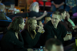 Patrons enjoy a tasty beverage while watching a presentation at the once-monthly Nerd Nite event, Monday, April 24, 2017, at Club 21 in the Uptown neighborhood of Oakland, Calif. (Photo by D. Ross Cameron)