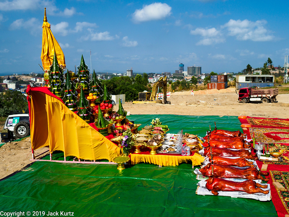 """14 FEBRUARY 2019 - SIHANOUKVILLE, CAMBODIA:  A Buddhist altar on the site of the groundbreaking for the Trimulia Tower, a joint Chinese-Malaysian mixed use development in Sihanoukville. The tower will be a few kilometers from central Sihanoukville. The developers said skyrocketting land prices in Sihanoukville forced them to select land further from downtown. There are about 80 Chinese casinos and resort hotels open in Sihanoukville and dozens more under construction. The casinos are changing the city, once a sleepy port on Southeast Asia's """"backpacker trail"""" into a booming city. The change is coming with a cost though. Many Cambodian residents of Sihanoukville  have lost their homes to make way for the casinos and the jobs are going to Chinese workers, brought in to build casinos and work in the casinos.      PHOTO BY JACK KURTZ"""