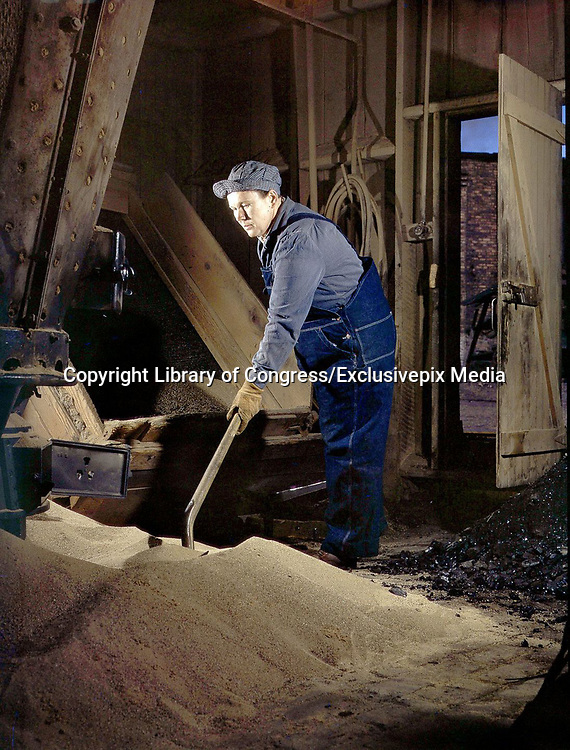 """Fascinating Color Portrait Photos of Women Railroad Workers During WWII<br /> <br /> World War II began when Hitler's army invaded Poland on September 1, 1939. However, it wasn't until the day after the Japanese attacked Pearl Harbor on December 7, 1941, that the United States declared war on the Axis Powers.<br /> <br /> The railroads immediately were called upon to transport troops and equipment heading overseas. Soon the efforts increased to supporting war efforts on two fronts-- in Europe and in the Pacific.<br /> <br /> Prior to the 1940s, the few women employed by the railroads were either advertising models, or were responsible primarily for cleaning and clerical work. Thanks to the war, the number of female railroad employees rose rapidly. By 1945, some 116,000 women were working on railroads. A report that appeared on the 1943 pages of Click Magazine regarding the large number of American women who had stepped forward to see to it that the American railroads continued to deliver the goods during the Second World War:<br /> <br />     """"Nearly 100,000 women, from messengers aged 16 to seasoned railroaders of 55 to 65, are keeping America's wartime trains rolling. So well do they handle their jobs that the railroad companies, once opposed to hiring any women, are adding others as fast as they can get them...""""<br /> <br /> In April 1943, Office of War Information photographer Jack Delano photographed the women of the Chicago & North Western Railroad roundhouse in Clinton, Iowa, as they kept the hulking engines cleaned, lubricated and ready to support the war effort.<br /> <br /> Photo shows: Mrs. Thelma Cuvage sifts and cleans sand for use in locomotives.<br /> ©Library of Congress/Exclusivepix Media"""