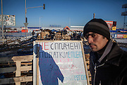 """A man passing the barrikades blockading a building supplies store named """"Epicenter"""" in the city of Lviv, Ukraine."""