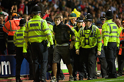 BIRMINGHAM, ENGLAND - Tuesday, October 14, 2008: A Wales fan is ejected from the match after invading the pitch against England during the UEFA European Under-21 Championship Play-Off 2nd Leg match at Villa Park. (Photo by Gareth Davies/Propaganda)