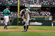Ichiro, who rang up Hall of Fame numbers in 11-plus seasons as a Mariner, bows to cheering fans at Safeco Field before his first at bat as a New York Yankee [July 23, 2012]. (Dean Rutz / The Seattle Times)