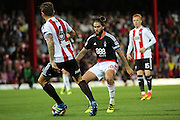 Nottingham Forest midfielder Henri Lansbury (10) battles for possession with Brentford defender Harlee Dean (6)  during the EFL Sky Bet Championship match between Brentford and Nottingham Forest at Griffin Park, London, England on 16 August 2016. Photo by Matthew Redman.