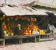 Melon seller in a fruit stall at a market in Samarkand (Uzbekistan). By Sergey Mikhaylovich Prokudin-Gorsky 1863 – 1944, Russian photographer. He is known for his pioneering work in colour photography of early 20th-century Russia